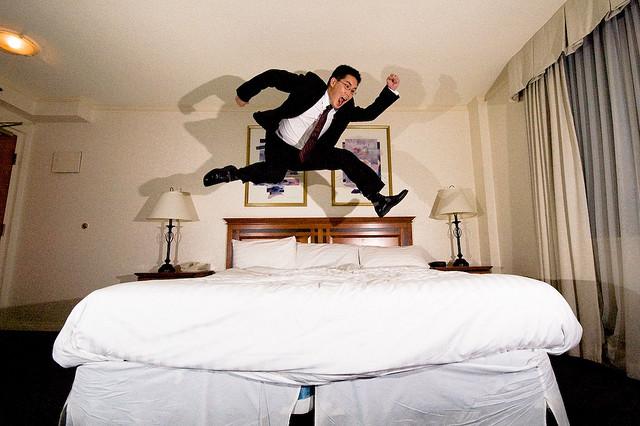 Hotel room man jump