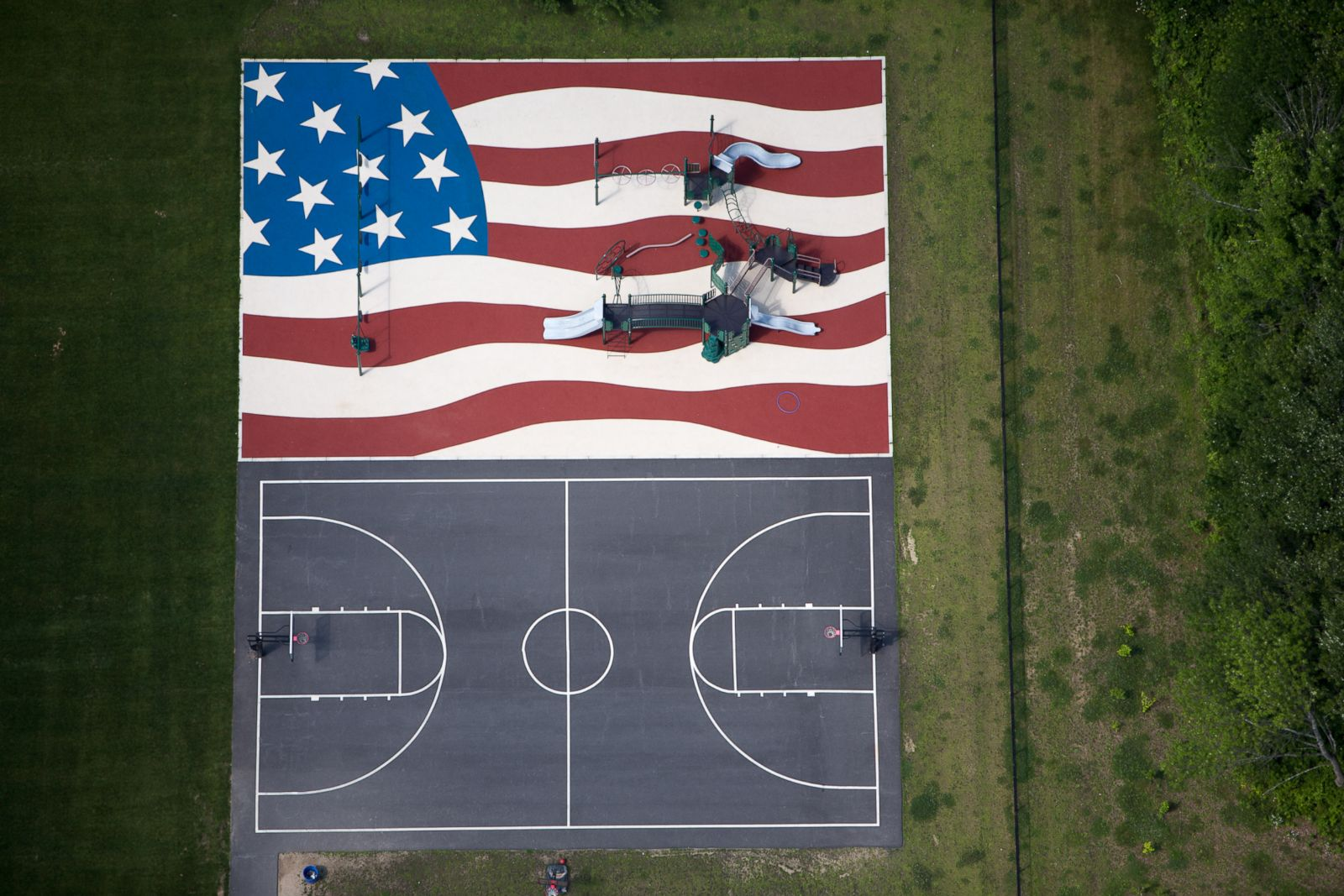 An American flag playground and a basketball court in Stow, Massachussetts