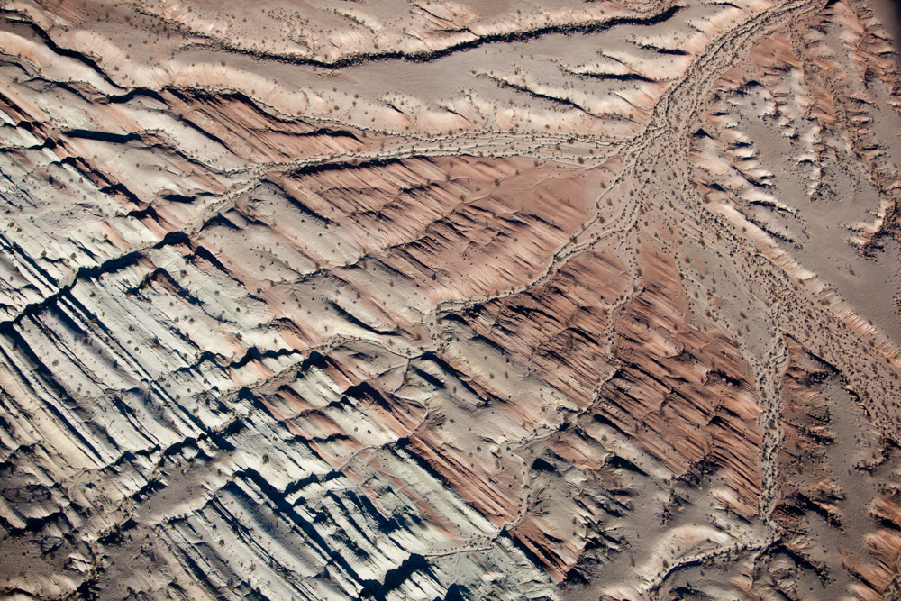 Drainage pattern across striated tilted interbeded rock