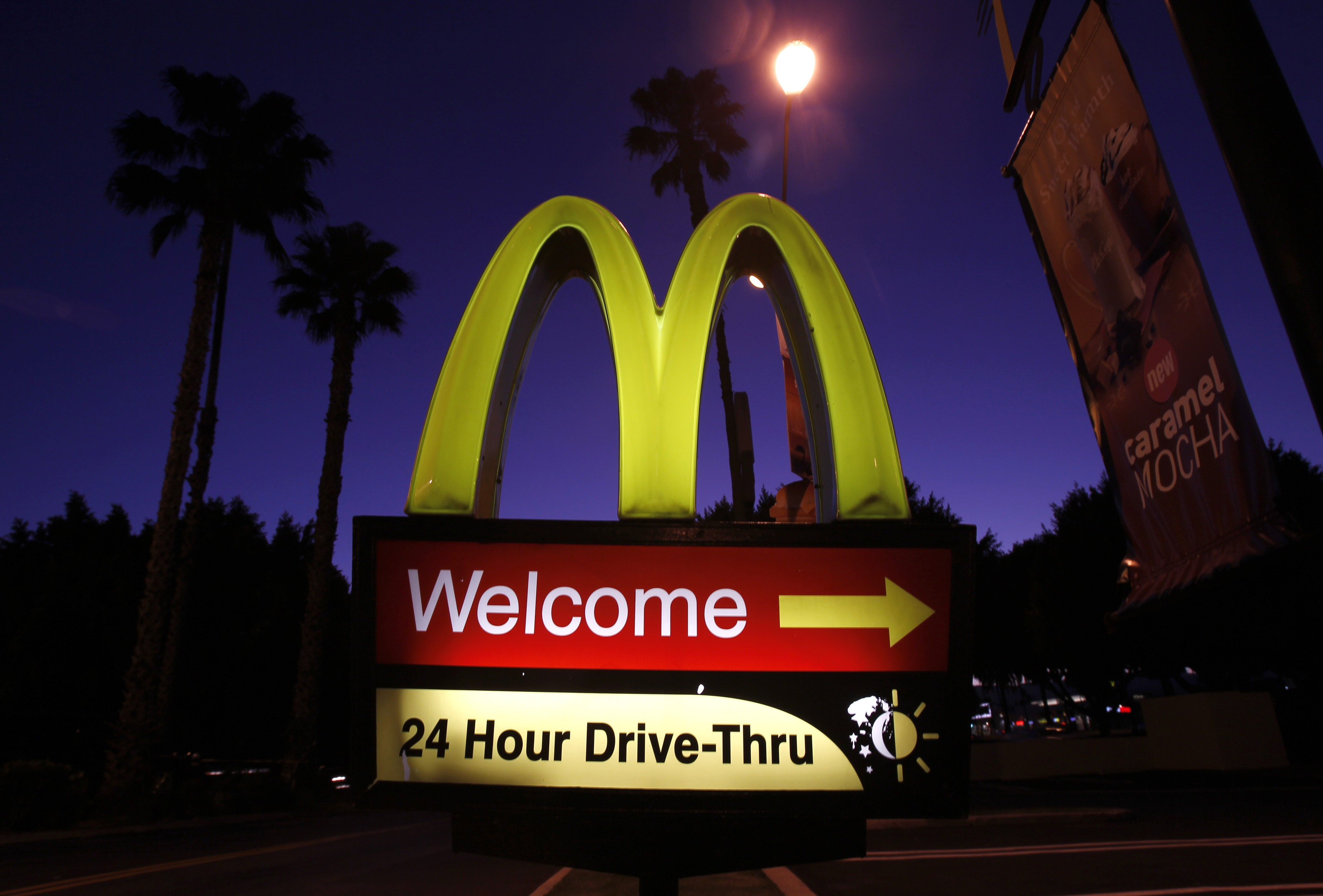 File photo of a McDonald's restaurant's drive-thru sign in Los Angeles