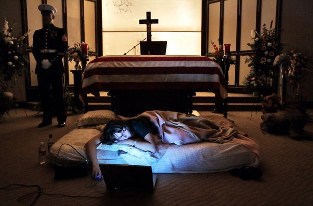 Wife of a fallen Marine, sleeps by his casket the night before his burial