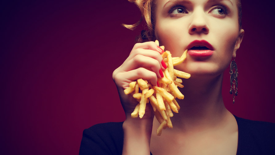 Woman holding French fries