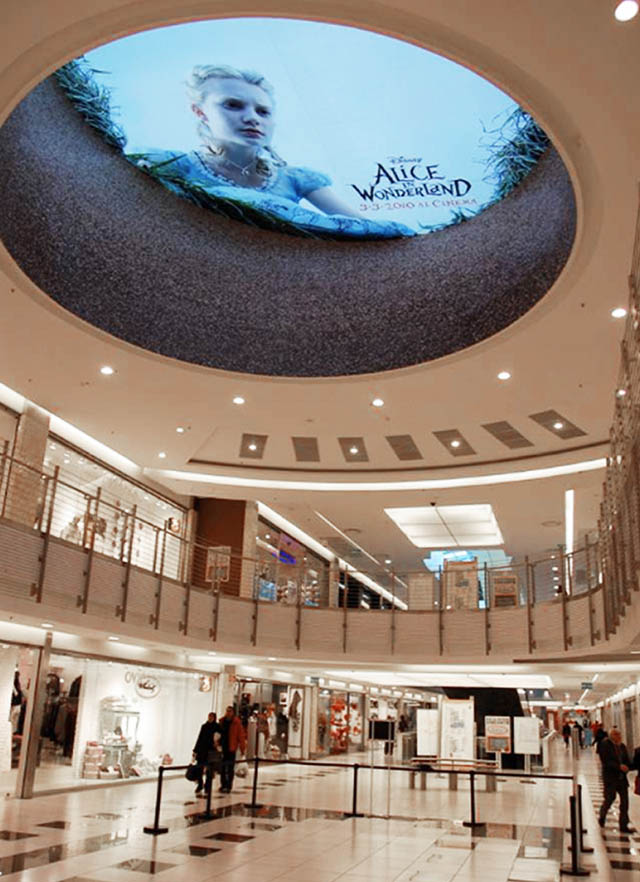 alice-in-wonderland-ceiling-ad-sticker-looking-down-into-mall