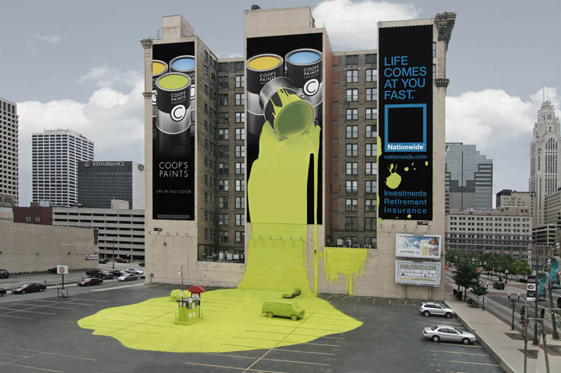 outdoor-ad-looks-like-giant-bucket-of-paint-spilled-onto-parking-lot-ground