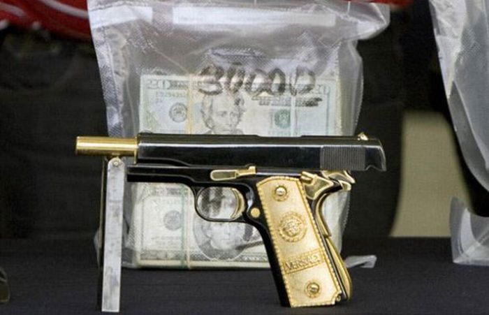 Mexican Drug Lord Home - 357 Magnum semi-automatics with solid gold grips