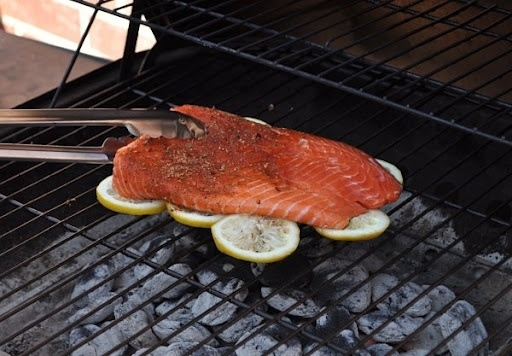 Grill fish on lemon slices