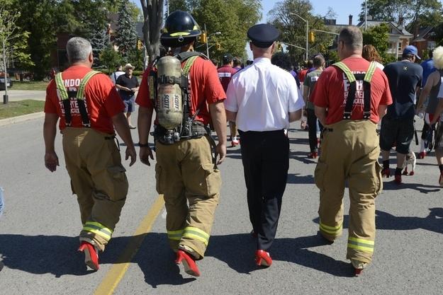Men walking in her shoes